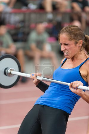 female lifting  barbell