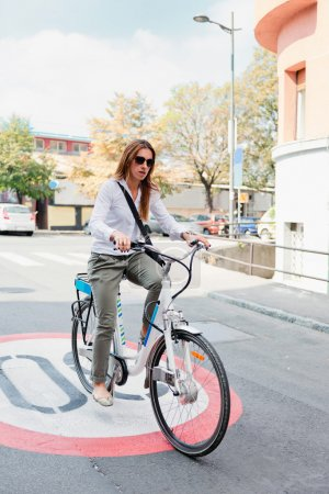 Young woman on electric bicycle