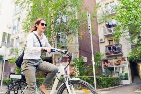 female E-bike commuter