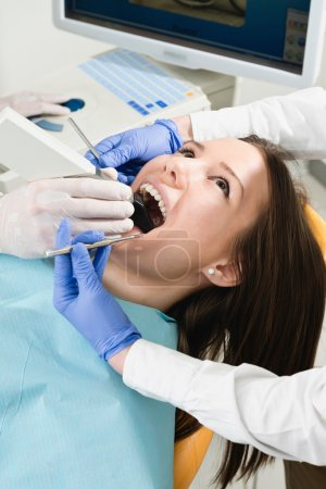 patient at Ceramic tooth reconstruction procedure