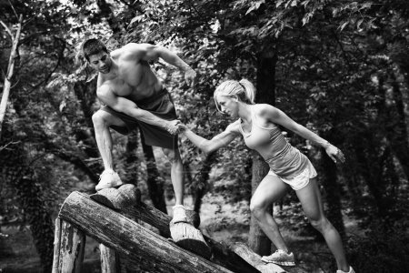 Crossfit couple on obstacle course