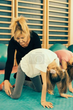 Physical therapist working with  children