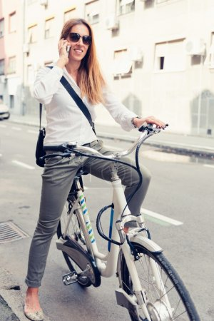 Female commuter on electric bicycle