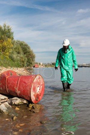 male Environmentalist approaching barrel