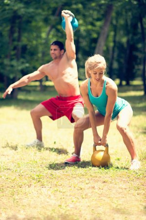 Fitness couple with kettle bells