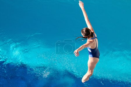 Girl in swimsuit falling down to water