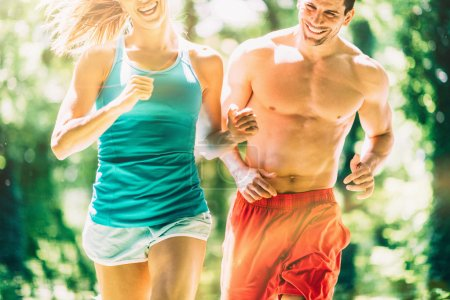 Competitive young couple runners