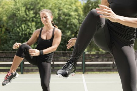 fitness people exercising outdoors