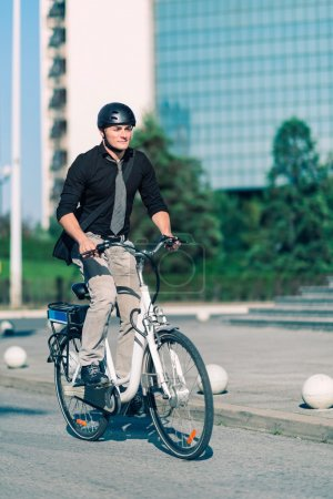 male Office worker using e-bike