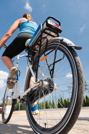 woman riding e-bike