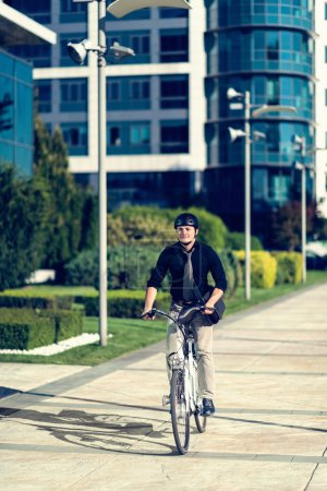 Young man using electric bicycle