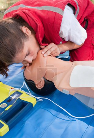Rescue breathing procedure performed on dummy