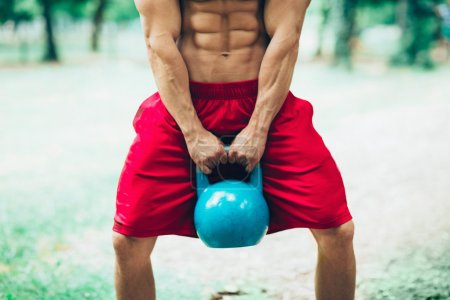 crossfit athlete with kettle bell