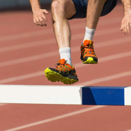 Photo for Steeplechase competitor feet on crossfit competition - Royalty Free Image
