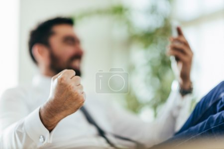 Businessman getting good news