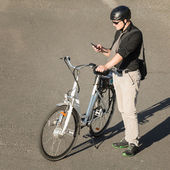 Person with e-bike and  phone