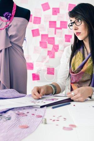 Fashion designer working  with sketch