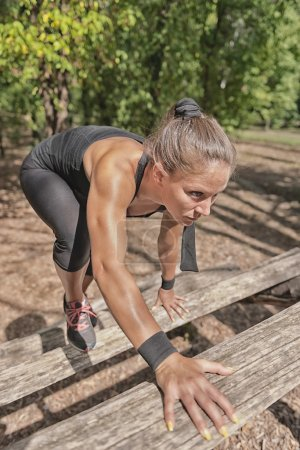 athlete crossing wooden barriers