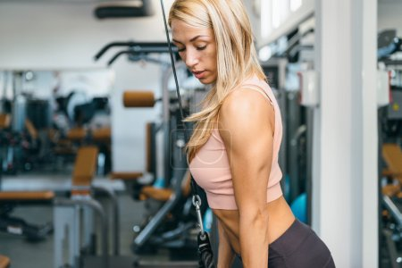 Attractive woman doing triceps exercise
