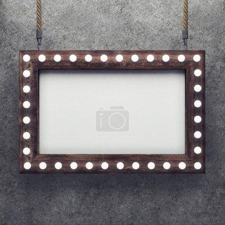 Photo pour Cadre en bois sur béton fond éclairée par des lampes à incandescence. rendu 3D - image libre de droit