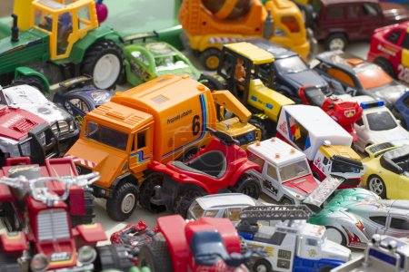 plastic toys and kid cars for concept of over-consumerism