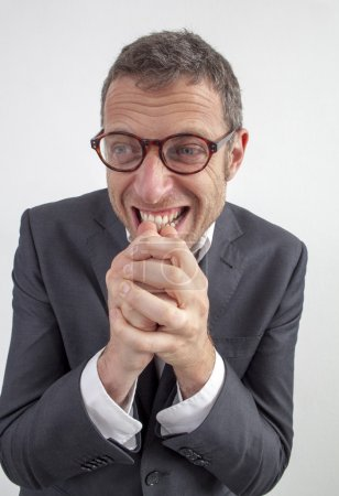 excited man enjoying expressing himself with fun hand gesture for wellbeing and serenity