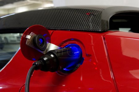 Electric car charging with plug
