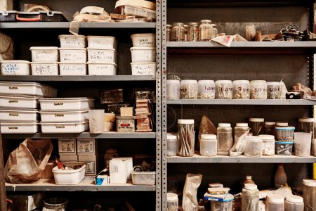 shelves in workshop with variety of different containers
