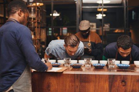 Professional baristas training new employees