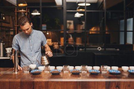 Professional barista preparing coffee
