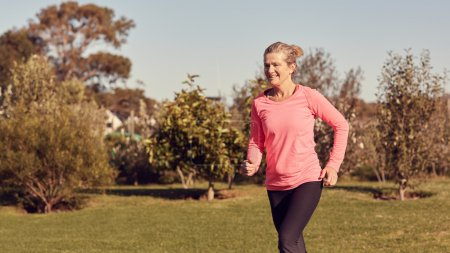 Athletic senior woman jogging outdoors