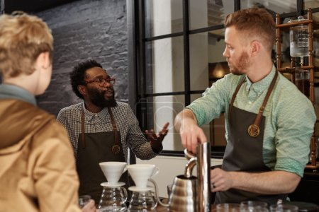 Manager explaining process to new barista