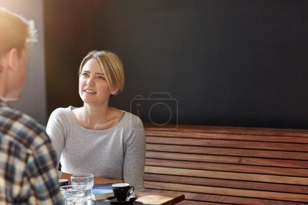Woman having coffee with man