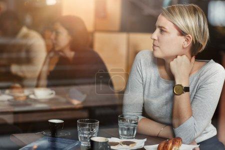 woman with trendy hair having coffee