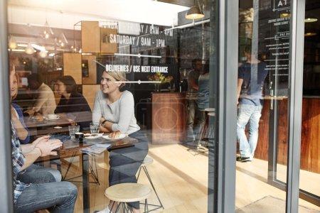 Woman enjoying coffee break with friends