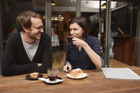Couple smiling at each other on date