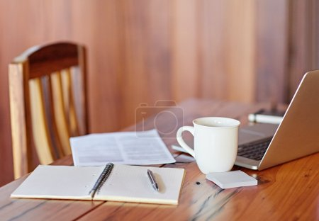 Photo for Office workspace with wooden table, laptop, documents and cup - Royalty Free Image