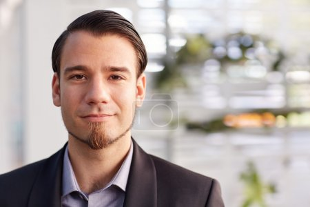 businessman looking at camera with positive expression