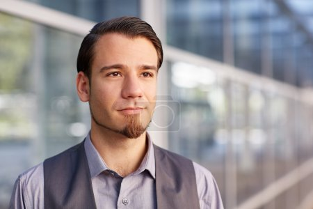 businessman looking away with positive and optimistic expression
