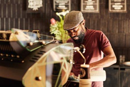 barista working behind espresso machine