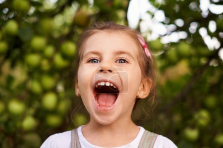 Photo for Portrait of a cute little girl making an excited face with her mouth wide open - Royalty Free Image