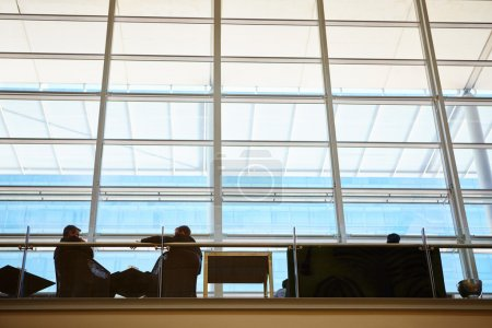 real businesspeople in motion through glass