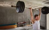 man lifting heavy training weights