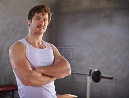 man with strong physique looking at camera