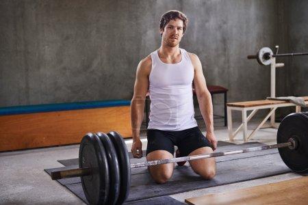 Fit personal trainer kneeling