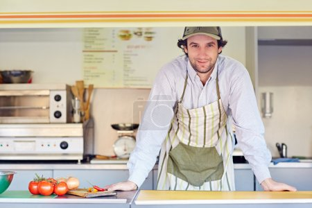 entrepeneur standing confidently in food stall