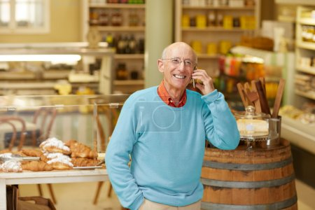 deli owner talking on phone