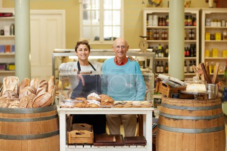 father and daugther standing in deli