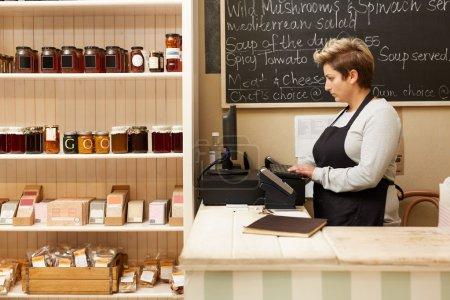 deli worker standing behind counter
