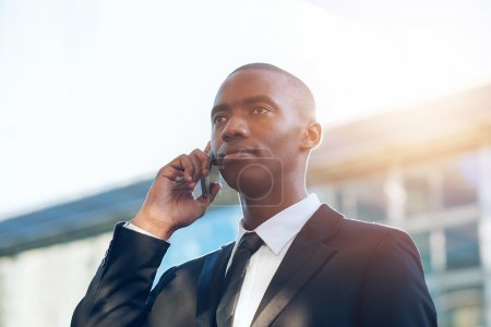Businessman holding phone to ear